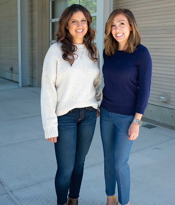 Our functional breathing experts, Sara and Khushbu standing together